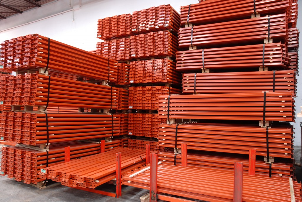 four large stacks of pallet rack beams