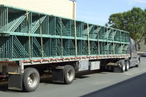 Semi truck bed full of used pallet racking